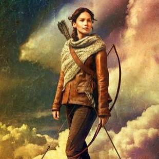 Katniss e seu arco no novo poster de Jogos Vorazes: Em Chamas